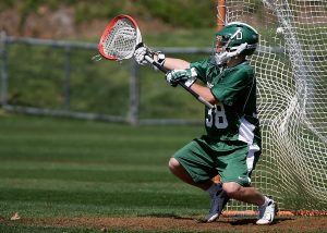College NCAA Lacross goalie in game