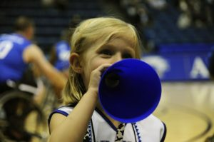 Little kid showing support for their booster club's team