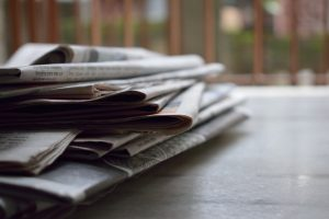 Stack of local newspapers