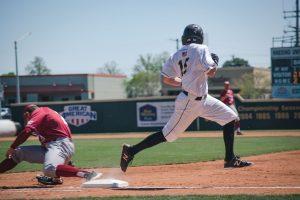 Baseball player crossing base