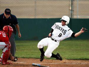 Baseball players sliding into home base