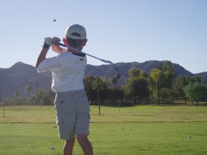 Junior golf player learning to play