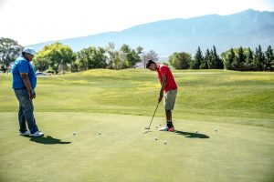 Golf Booster Club supporting time on the course for student and coach