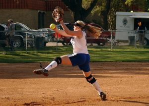 Softball pitcher in middle of wind-up