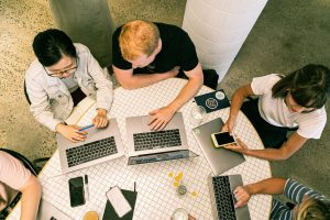 Marketing team working on developing a marketing plan for an organization.