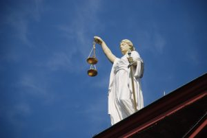 Lady Justice on top of courthouse building.