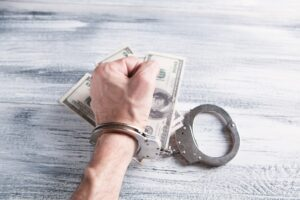 Booster club pay to play scheme can lead to handcuffs and criminal charges.