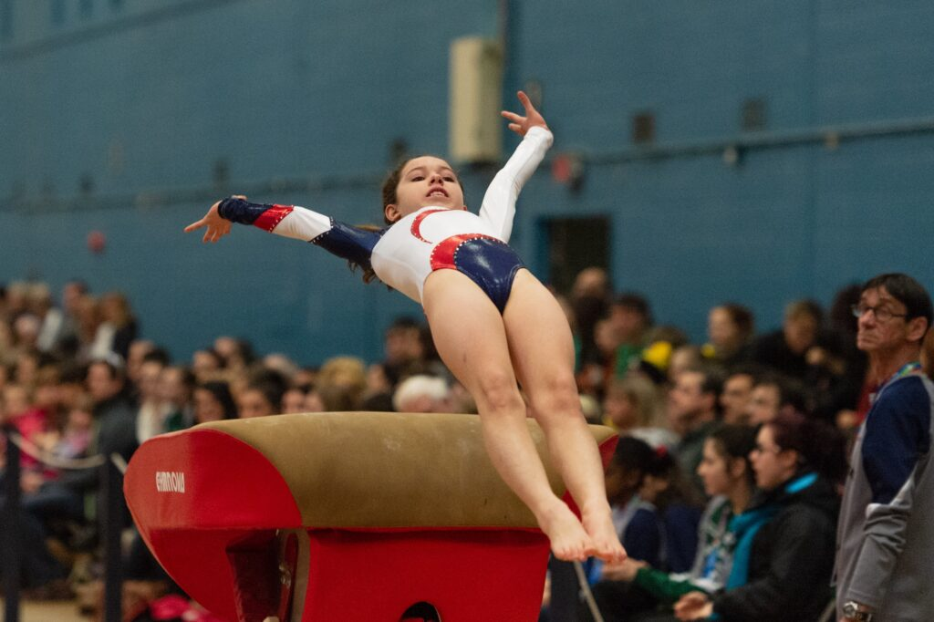 Gymnast competing at event supported by her gymnastics booster club