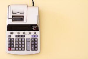 Adding machine used for accounting and managing finances.