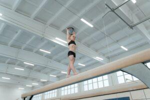 Young gymnast on the balance beam.