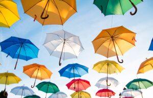 Multicolored ig umbrellas in the air.